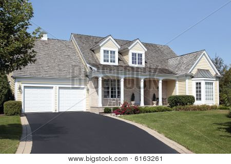 Home With Columns And Double Garage