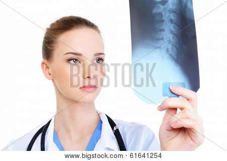 young attractive female practitioner looking at X-ray poster