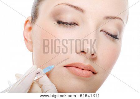 Shot in the female cheek - female  face close-up