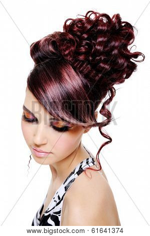 fashion creative hairstyle on the head of the young beautiful woman