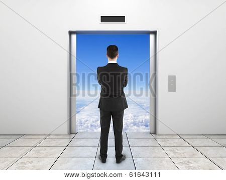 man looking at elevator with opened door to sky poster
