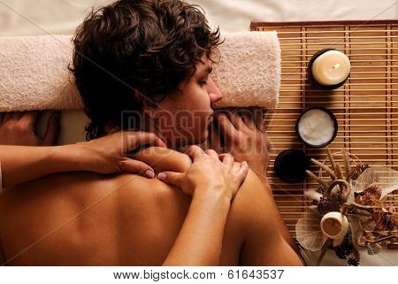 The young Man on spa treatment - recreation,  rest,  relaxation and massage. High angle view