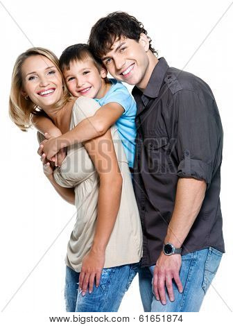 Happy family with child posing on white background