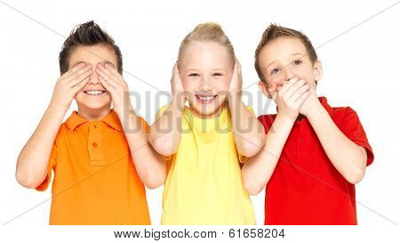 Funny faces of happy children doing