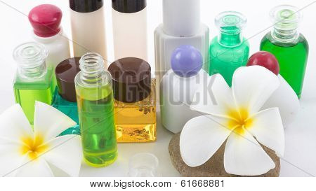 Isolated Of The Shampoo Bottle Set With Plumeria Flower In Spa On White Background