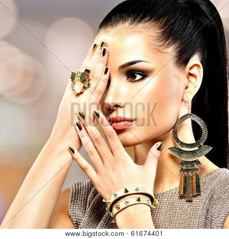 Portrait of the beautiful fashion woman with black makeup and golden manicure poster