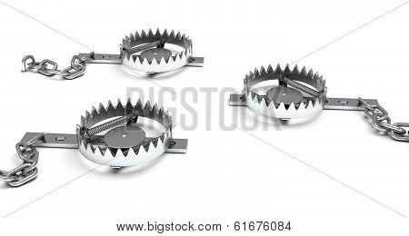 Metal animal traps open.
