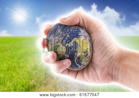 Hand Is Holding To The Stone World On Blue Sky Background, The World Map By Nasa