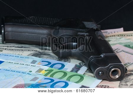 money as a backdrop and a gun