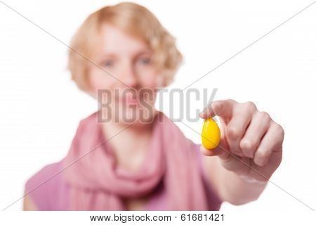 Girl Holding Easter Egg In Front Of The Cameras