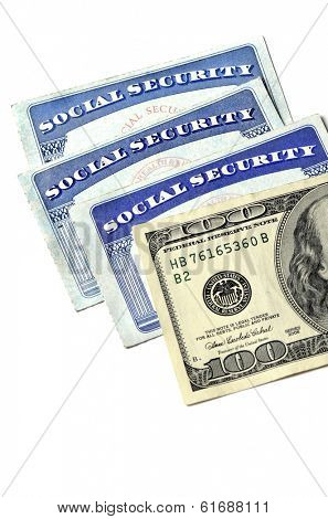 Detail of several Social Security Cards and cash money symbolizing retirement pensions financial safety