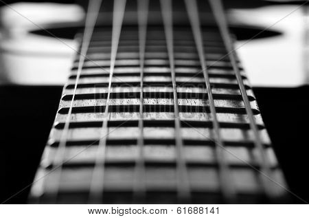 Closeup detail of steel guitar strings and frets for making music