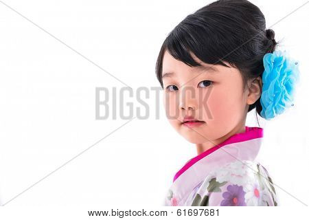 Asian cute girl wearing a kimono on white background