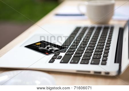 Close up of credit card on laptop  computer keyboard