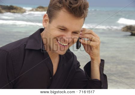 Man With Cellphone At Beach