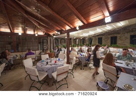 DUBROVNIK, CROATIA - MAY 27, 2014: Guests and waitress in Proto restaurant, one of Dubrovnik's best known places for fish specialities.