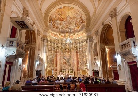 DUBROVNIK, CROATIA - MAY 28, 2014: People on mass in Jesuit church of St. Ignatius. The church and collegium complex is considered to be the finest baroque set of buildings in Dubrovnik.