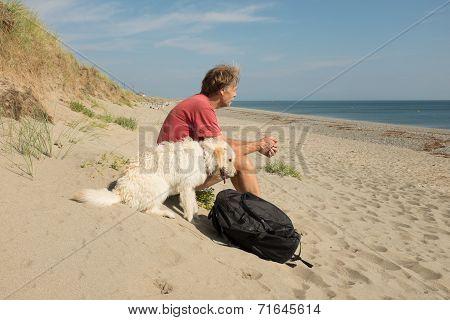 Man And Dog On Beach.