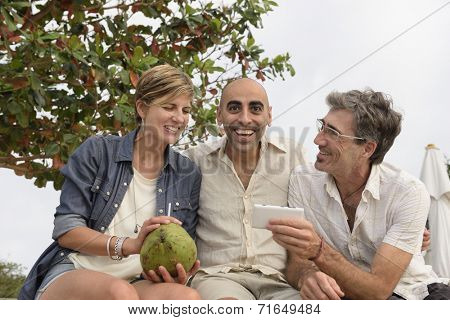 Middle aged group of friends talking and laughing