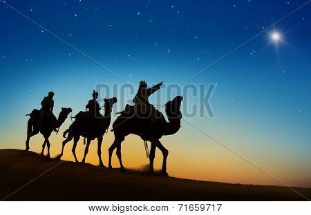 Three kings looking at the star.