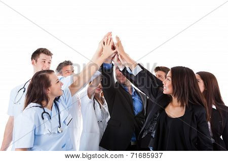 Doctors And Managers Making High Five Gesture