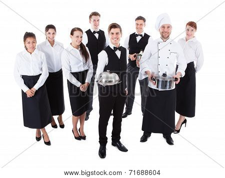 Large group of waiters and waitresses. Isolated on white poster