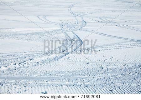 Ski tracks on a fresh groomed piste