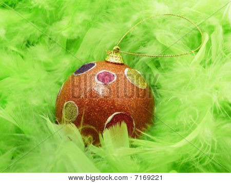 Background with green feathers and Christmas ball poster