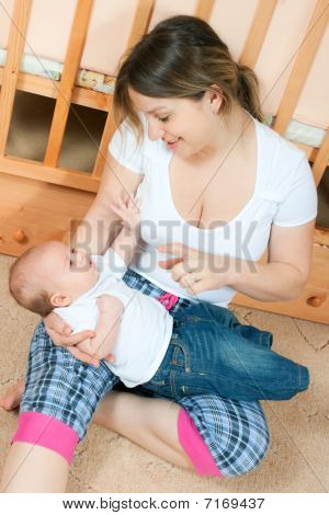 Mother And Baby In Living Room