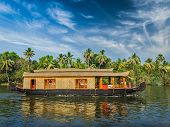 Travel tourism Kerala background - houseboat on Kerala backwaters. Kerala, India poster