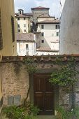 Barga (Lucca Tuscany Italy): buildings in the historic town in Garfagnana poster