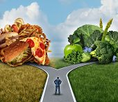 Diet decision concept and nutrition choices dilemma between healthy good fresh fruit and vegetables or greasy cholesterol rich fast food with a man on a crossroad trying to decide what to eat for the best lifestyle choice. poster