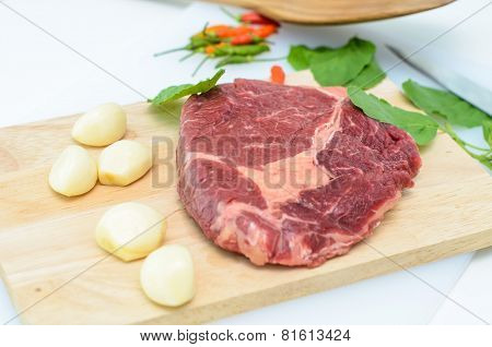 Raw Fresh Meat Slices On Wooden Chopping Board.