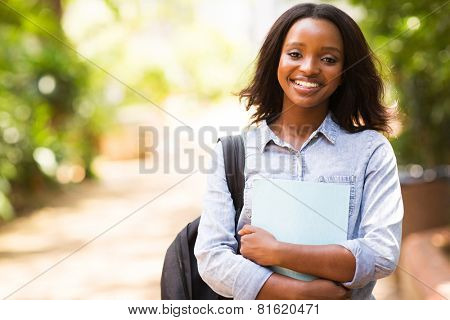 portrait of african college student holding a book