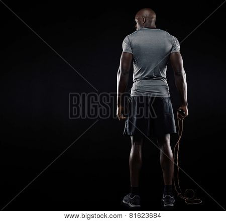 Muscular Man Standing With Jumping Rope