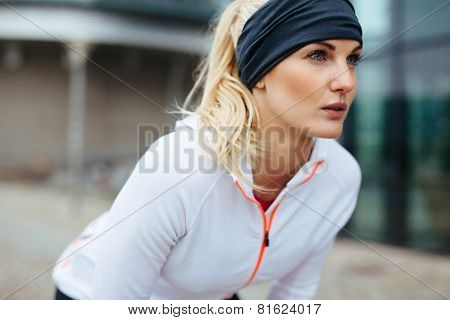Sporty Woman On Outdoor Workout Looking Confident