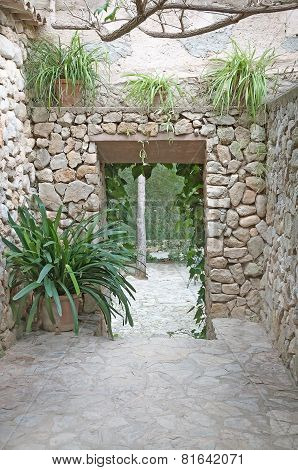 Drystone outdoor room with plants