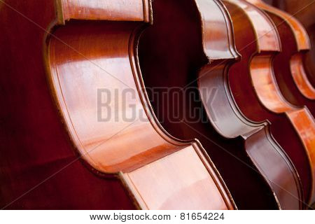 Four Double Basses In A Row