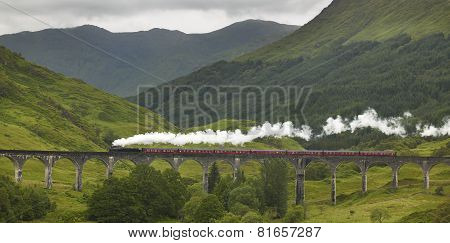 Train Passing A Classic Bridge