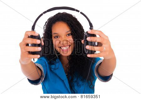 Portrait Of A Beautiful Black Woman With Headphones Listening To Music