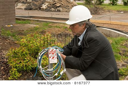 Man Attaching Lockout Tag