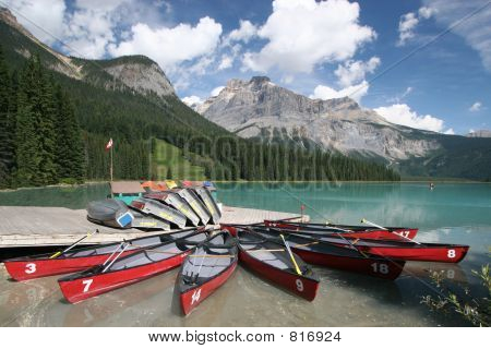Eight red canoes