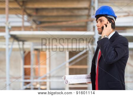 Portrait of an architect talking on the phone