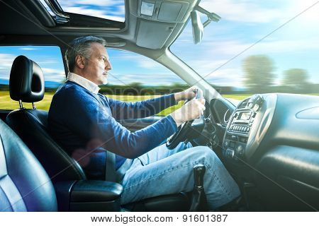 Portrait of a man driving his SUV