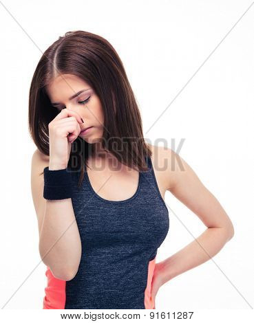 Fitness woman covering her nose with hand isolated on a white background
