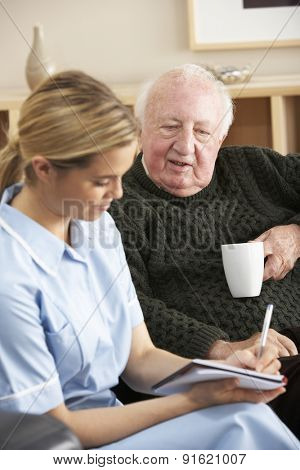Nurse visiting senior man at home