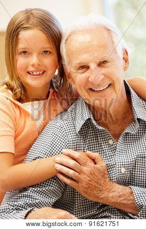 Senior man and granddaughter at home