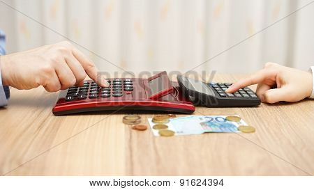 Man And Woman Calculating Hot To Spli T Little Money, Concept Of Poverty