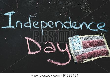black chalkboard in classroom with flag of us...Independence Day