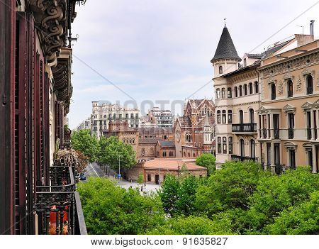 View into  Valencia street in Barcelona - residential Eixample district with church in background, Spain poster